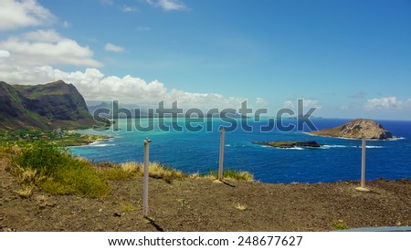 Makapuu beach Hawaii shoreline from the Makapuu point lighthouse view and Offshore Rabbit Island, Manana Island - stock photo