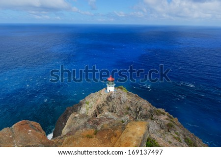 Makapuu Point lighthouse off Oahu, Hawaii, off of the coast of Oahu, Hawaii. The Makapuu Point Light on the island of Oahu has the largest lens of any lighthouse in the United States. - stock photo