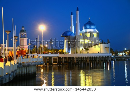 MAKASSAR, INDONESIA � JUNE 22: Masjid Amirul Mukminin on June 22, 2013 in Makassar, Indonesia.Masjid Amirul Mukminin is a floating mosque and is located on the Losari Beach.It was inaugurated in 2012. - stock photo