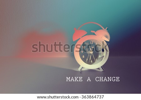 MAKE A CHANGE with alarm clock , color filter image , time concept , business concept , idea concept - stock photo