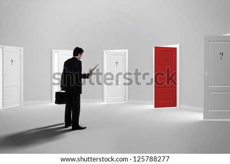 Make a decision. Choose a job. Be interviewed. Recruitment. Achieving the goal. Cease to be unemployed. Due to bureaucracy. With question marks on the red open door. - stock photo
