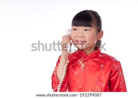 Make a phone call chinese girl in traditional Chinese cheongsam, isolated on white background - stock photo