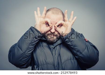 Make hands binoculars. - stock photo