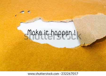 Make it happen! appearing behind torn brown envelope - stock photo