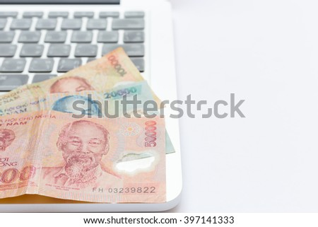 Make money with computer laptop, Vietnam currency, Dong  - stock photo