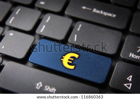 Make money with internet concept: blue key with golden euro sign on laptop keyboard. Included clipping path, so you can easily edit it. - stock photo