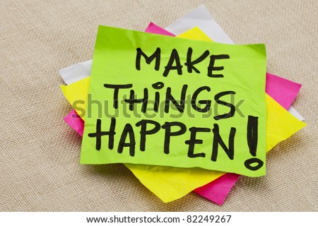Make things happen motivational reminder - handwriting on a green sticky note - stock photo
