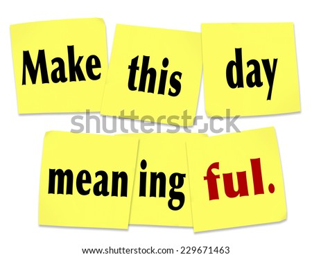 Make This Day Meaningful wods on yellow sticky notes as a saying or quote to do something important or memorable on this date - stock photo