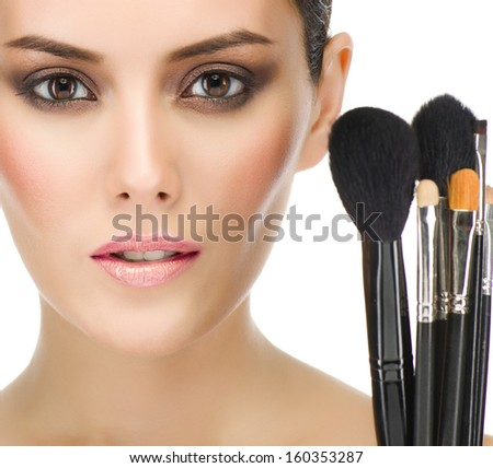 make up , beauty woman face, brushes, portrait of attractive young caucasian girl brunette , close up , isolated on white , studio shot ,  looking at camera, eyes, lips - stock photo