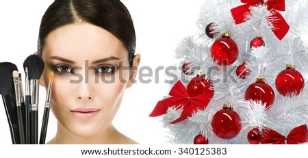 make up  beauty woman face brushes portrait of attractive young caucasian girl brunette  close up  isolated on white  studio shot head and shoulders looking at camera eyes lips christmas new year tree - stock photo