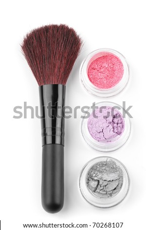 Make-up brush and powder eye shadows in jars isolated on white background. - stock photo