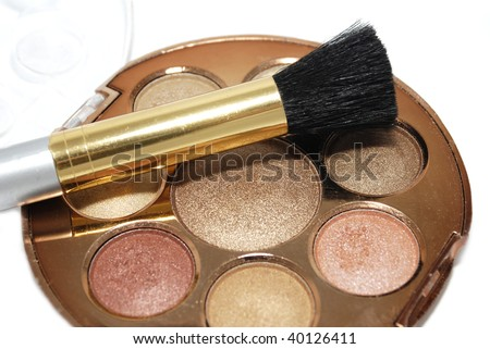 Make-up brush with copper gold face powder - stock photo