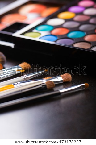 Make-up brushes and eye shadow close-up - stock photo
