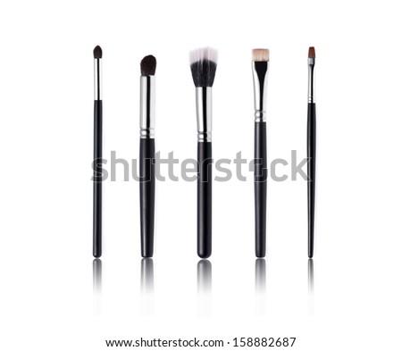 Make-up Brushes isolated on white - stock photo