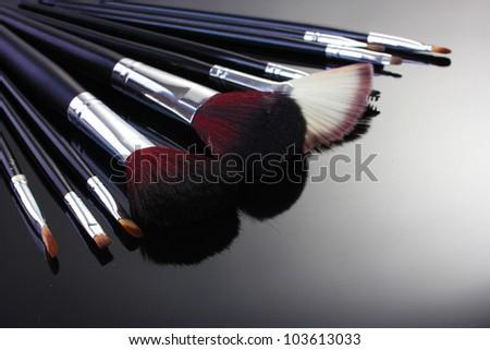 make-up brushes on grey background - stock photo