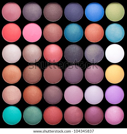 Make-up colorful eyeshadow palettes isolated on black background - stock photo