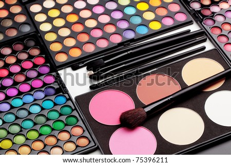 Make-up colorful eyeshadow palettes with makeup brushes - stock photo
