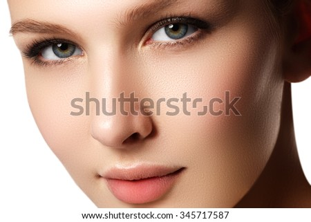Make-up & cosmetics. Closeup portrait of beautiful woman model face with clean skin on white background. Natural skincare beauty, clean soft skin. Spa treatment - stock photo