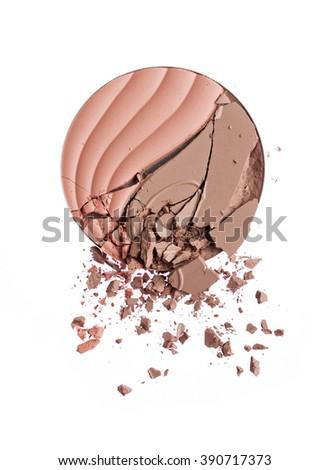 Make up crushed powder on white background - stock photo