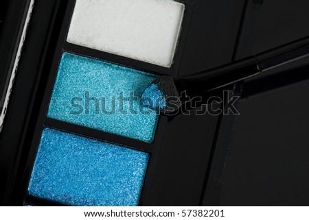 make-up eyeshadows and cosmetic brush - stock photo