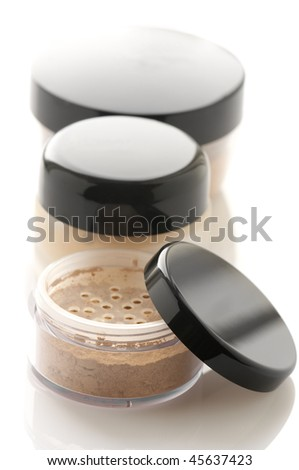 Make-up: jars of loose powder and toner on white background. - stock photo