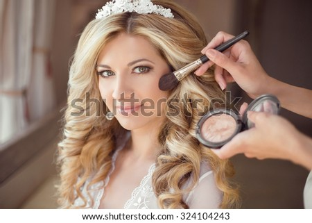 make up rouge. Healthy hair. beautiful smiling bride wedding portrait. Stylish makes makeup Young woman with long curly hair style. - stock photo
