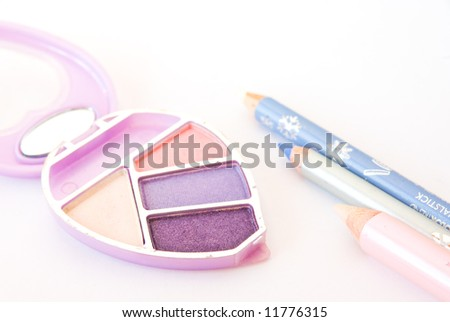 Make-up still life isolated on white background, shallow DoF. - stock photo