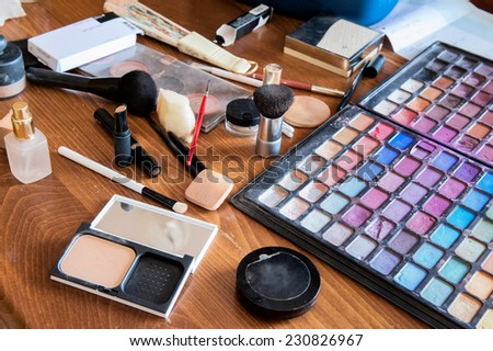 Make-up tools on a wooden table - stock photo