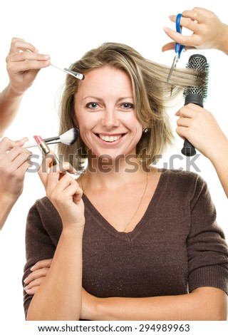 Make up woman with many hands. Makeup brushes. Isolated on white background - stock photo