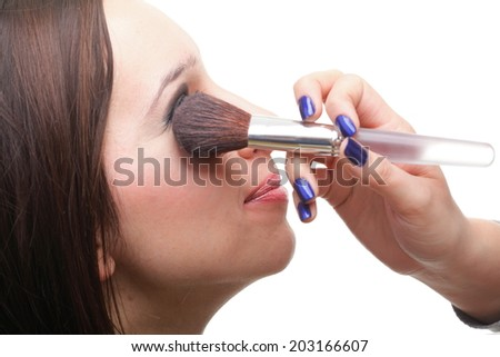 Makeover beautiful young brunette woman applying powder with a brush isolated on white - stock photo