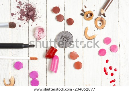 makeup accessories on white wood table  - stock photo