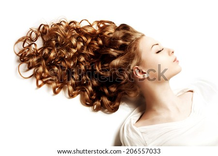 Makeup and hairstyle. Young beautiful woman with luxurious curly hair. Modern stylish trendy girl with curls, long groomed hair healthy - stock photo