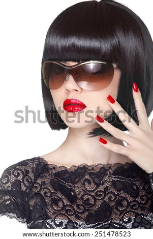 Makeup and manicured polish nails. Fashion brunette woman wearing in sunglasses isolated on white background. Professional model. - stock photo