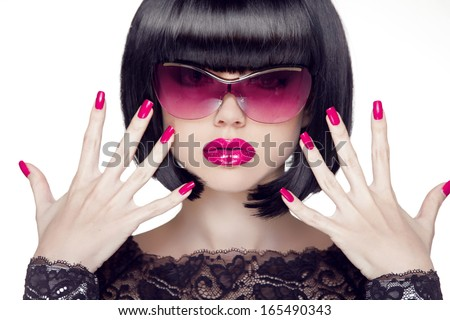 Makeup and manicured polish nails. Sexy brunette woman showing hands isolated on white background. Professional model. - stock photo