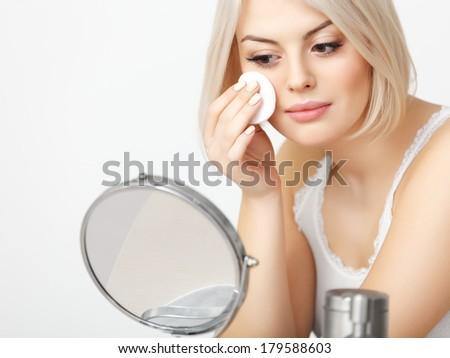 Makeup Applying. Beautiful Woman doing Daily Makeup. Cosmetic Sponge applying - stock photo