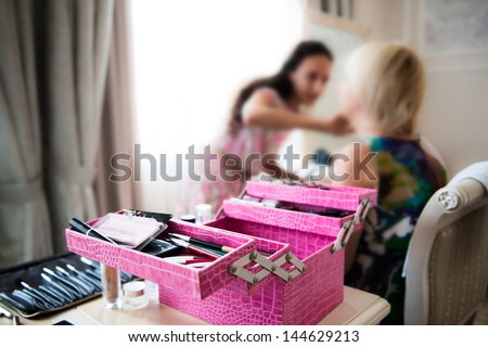 Makeup artist at the work with client - stock photo