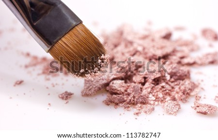 makeup brush and brown eye shadows on white background - stock photo