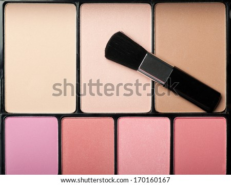 makeup brush and cosmetic powder close up. Top view - stock photo
