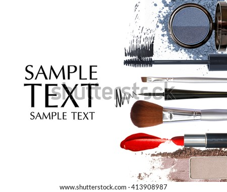 makeup brush and cosmetics on white background with copy space - stock photo