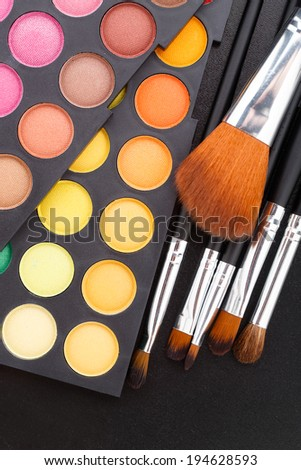 Makeup brushes and shadows - stock photo
