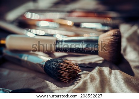 Makeup brushes of different shapes - stock photo