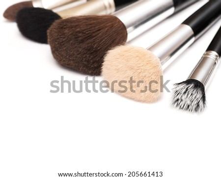 makeup brushes of different sizes and colors - stock photo