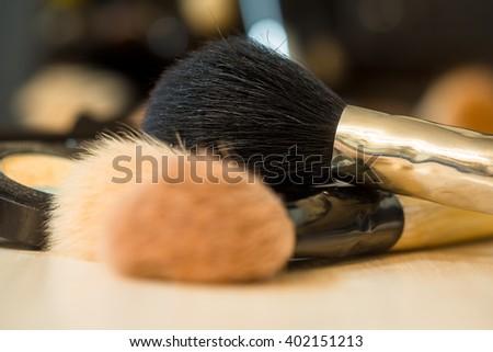 Makeup brushes on background of tabel. Make-up background  - stock photo