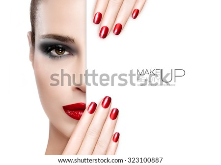 Makeup Concept. Beautiful fashion model girl with smoky eye makeup, foundation on a unblemished skin and trendy red lipstick to match her manicured nails, half face with a white card template - stock photo