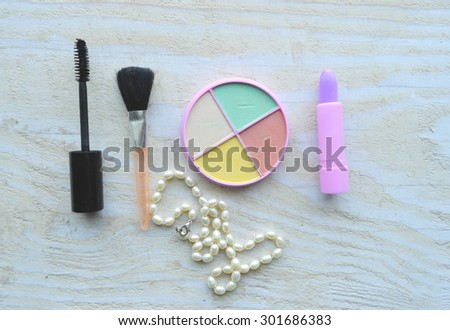 Makeup Eyeliner brush with bottle ,set of cosmetics,Make-up and brushes,powder, puff, mascara, eyeliner on wood table,false eyelashes,brush  - stock photo