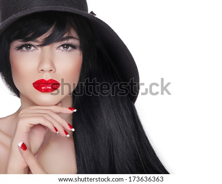 Makeup. Long hair. Fashion Brunette Woman Portrait in black hat isolated on White background. Red lips. Manicured nails. - stock photo