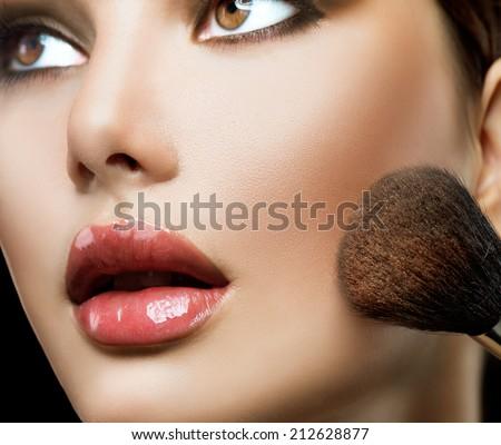 Makeup. Make-up Face. Big Make up brush. Makeup applying concept. Beautiful fashion model girl face closeup.  - stock photo