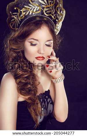 Makeup. Manicured nails. Russian girl model in exclusive design clothes on manners old-Slavic. Close-up portrait. - stock photo