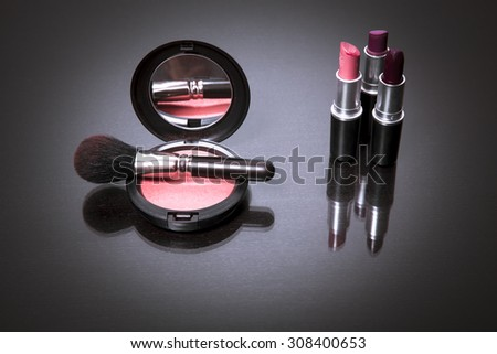 Makeup products on dark background with copy space for your text. Cosmetics and Make-up concept. Studio shot. Horizontal picture - stock photo