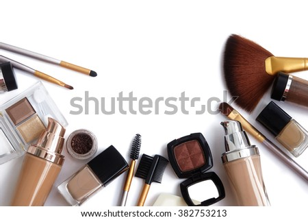 Makeup tools and accessories. Brow eyeshadows, naturel skin foundation for clean ton on face, nail polish, make-up brushes  - stock photo